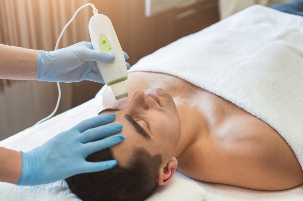 Man getting facial treatment at beauty salon